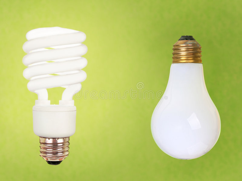 Download CFL And Regular Bulbs On Green Stock Image - Image: 3202885