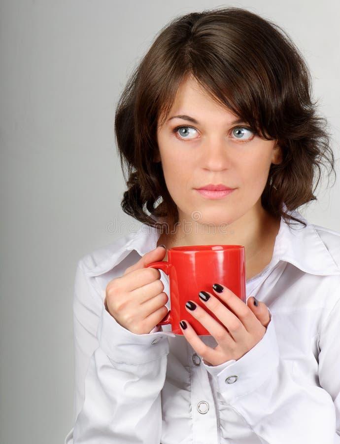 Chá bebendo da mulher imagens de stock royalty free