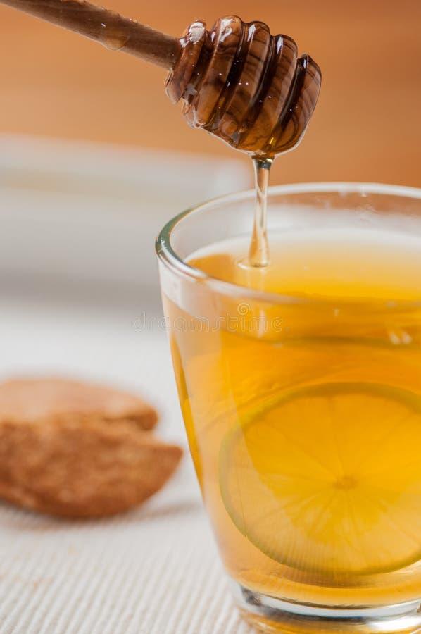 Chá com mel e limão fotografia de stock