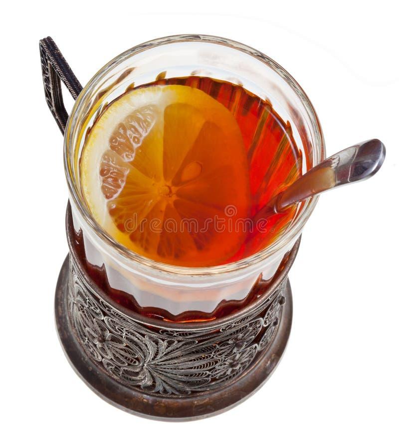 Chá com o limão no vidro do vintage com colher fotografia de stock royalty free