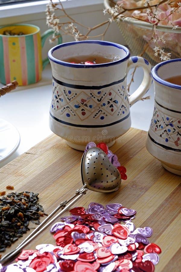 Chá do dia de Valentim para o lado largo de dois retratos foto de stock