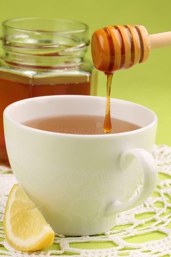 Chá do mel com limão imagens de stock