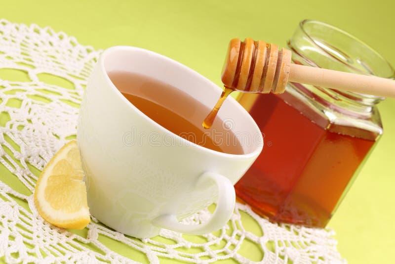 Chá do mel com limão imagens de stock royalty free
