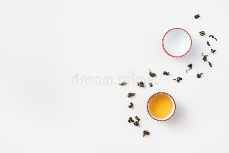 Chá do oolong de Formosa e copo de chá frescos fotografia de stock