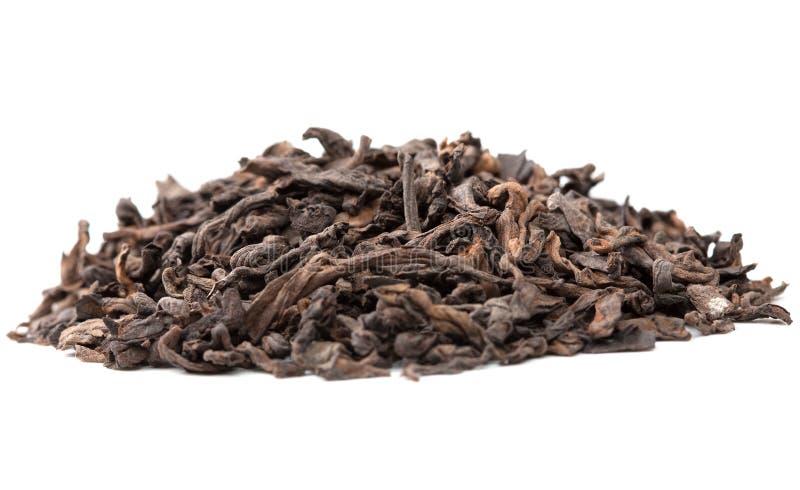 Chá Plutônio-erh chinês no branco fotografia de stock