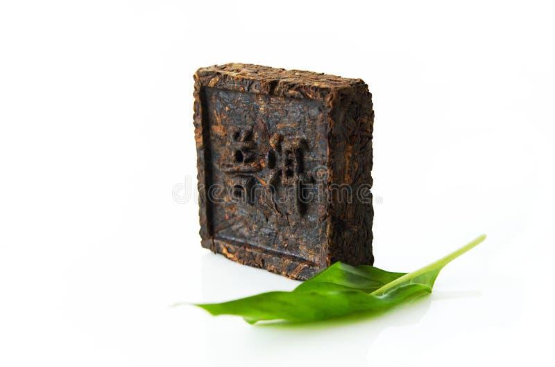 Chá pressionado, chá de Plutônio-erh do hieroglyph imagem de stock