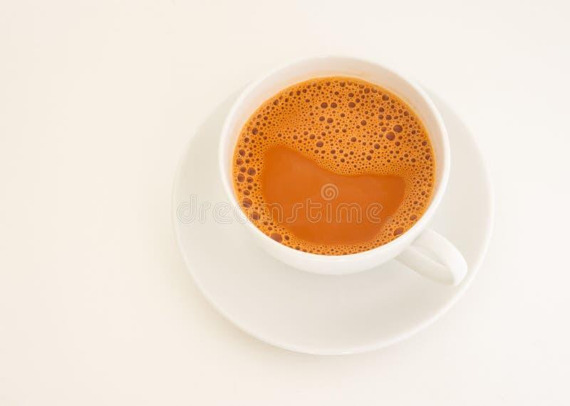 Chá quente do leite no copo imagem de stock royalty free
