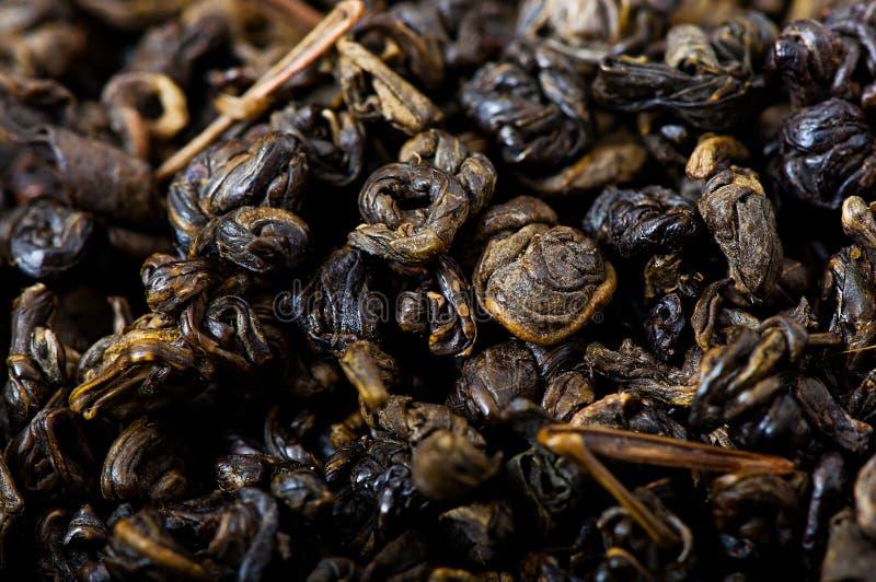 Chá verde, folhas de chá secadas imagens de stock royalty free