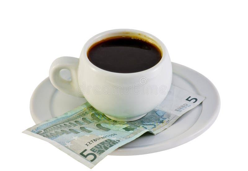 Chávena de café no euro- dinheiro fotos de stock royalty free