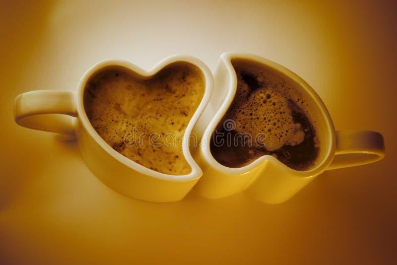 Chávenas de café dadas forma coração imagens de stock royalty free