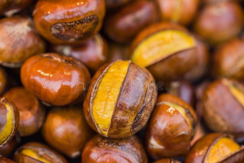 Châtaignes rôties par sucre image stock