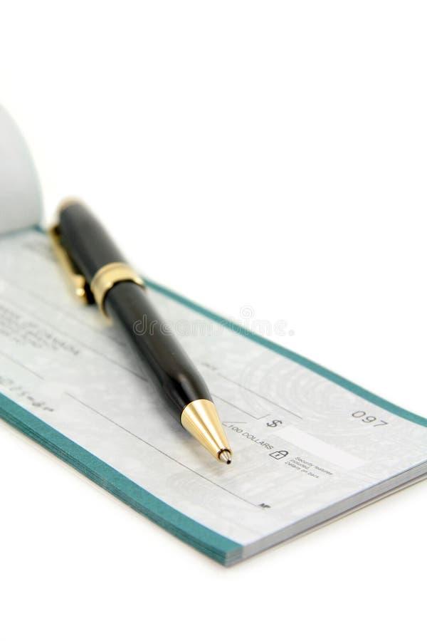 Chèque avec le crayon lecteur photographie stock