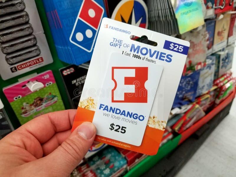 chèque-cadeau de fandango dans une main photo stock