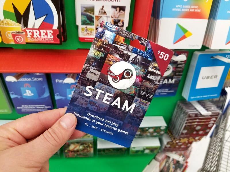 Chèque-cadeau de vapeur dans une main photographie stock