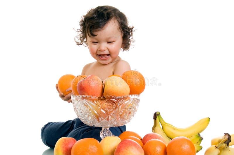 Chéri avec des fruits. photographie stock libre de droits