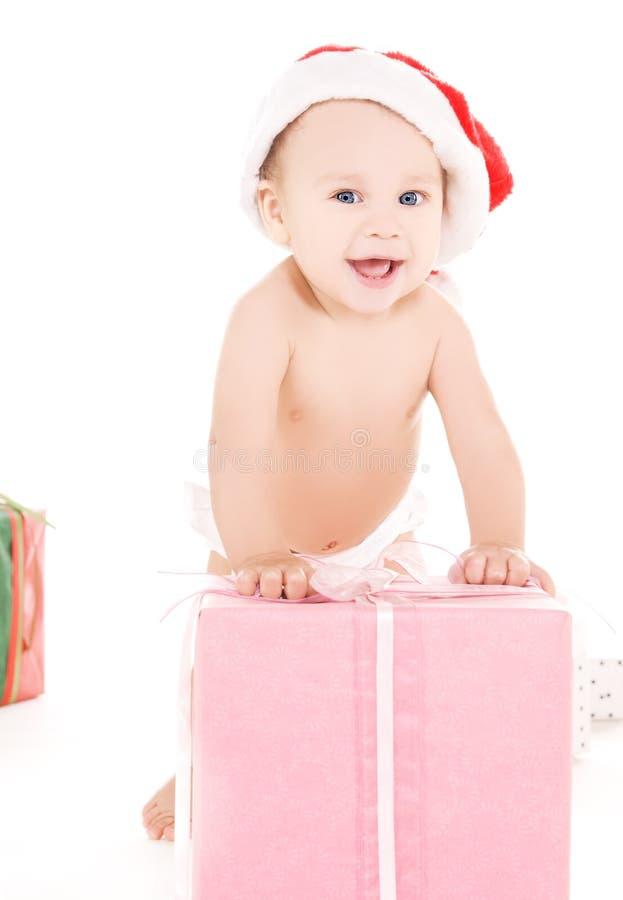 Chéri d'aide de Santa avec des cadeaux de Noël photographie stock libre de droits