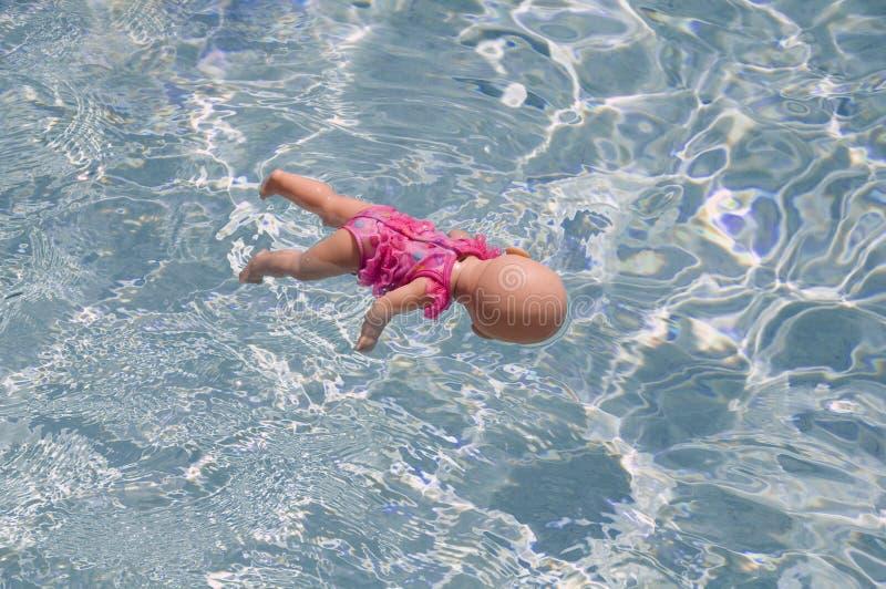 chéri - jouet de flottement de poupée images libres de droits
