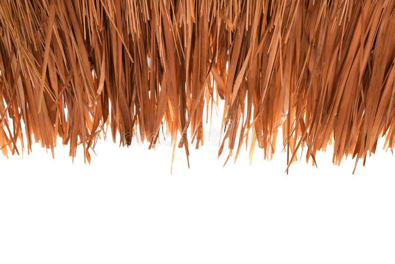 Chíbese los tejados, cubiertos con paja, en el recorte blanco del fondo fotografía de archivo libre de regalías