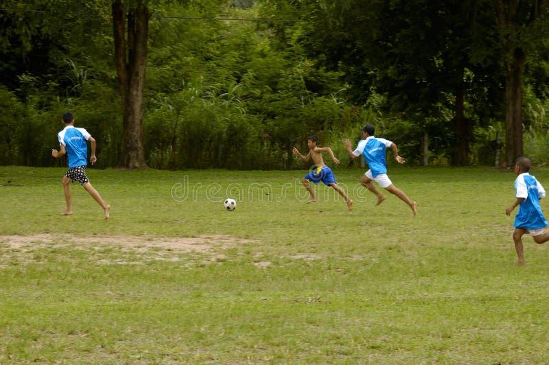 chłopak gra piłki nożnej grać tajskich young zdjęcie royalty free