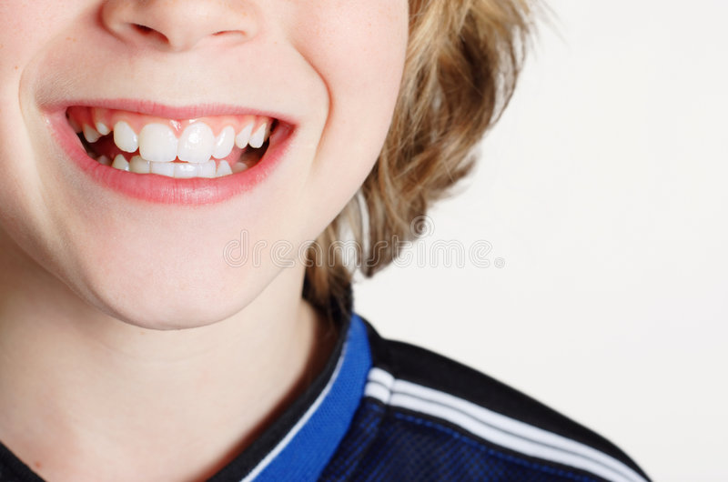 chłopak się uśmiecha zdjęcie stock