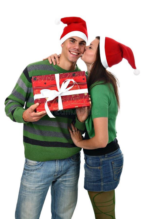 chłopaka dziewczyny kapeluszowa chwyta całowania teraźniejszość Santa obraz royalty free