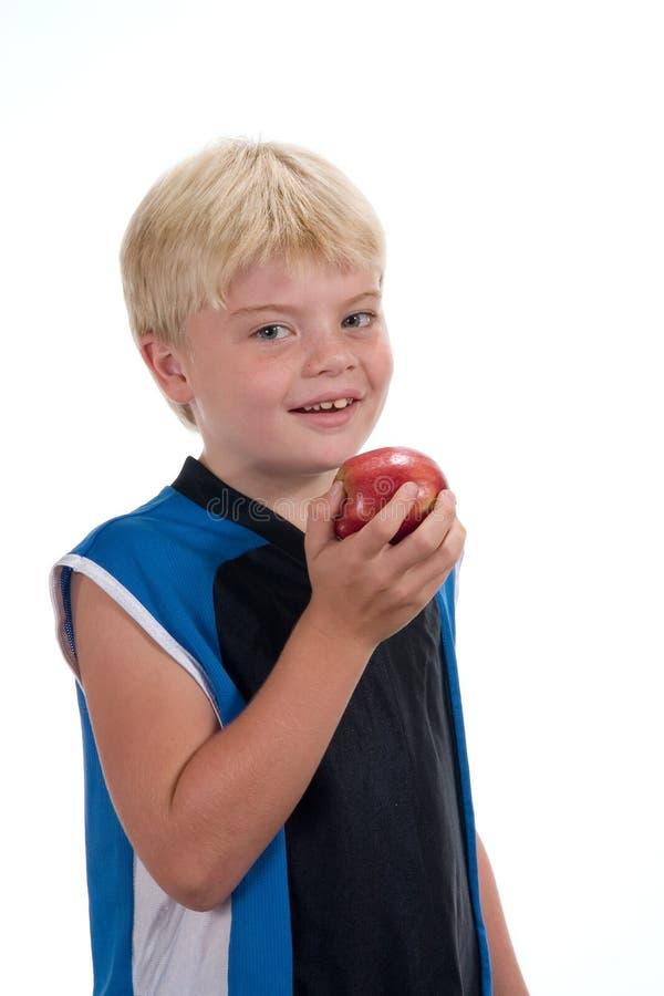 chłopcy jabłkowy jedzenie zdjęcia stock