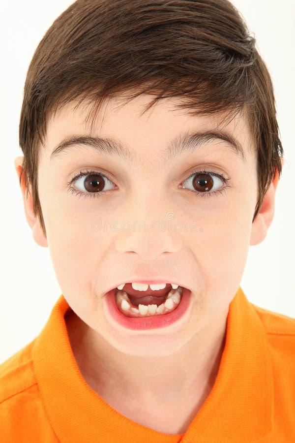 chłopiec atrakcyjna twarz robi niemądrą zdjęcia royalty free