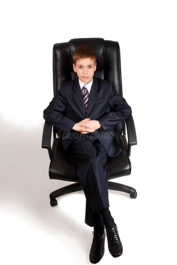 chłopiec biznesowi krzesła potomstwa fotografia royalty free