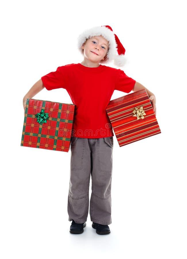 chłopiec bożych narodzeń prezenty target1286_1_ potomstwa fotografia royalty free