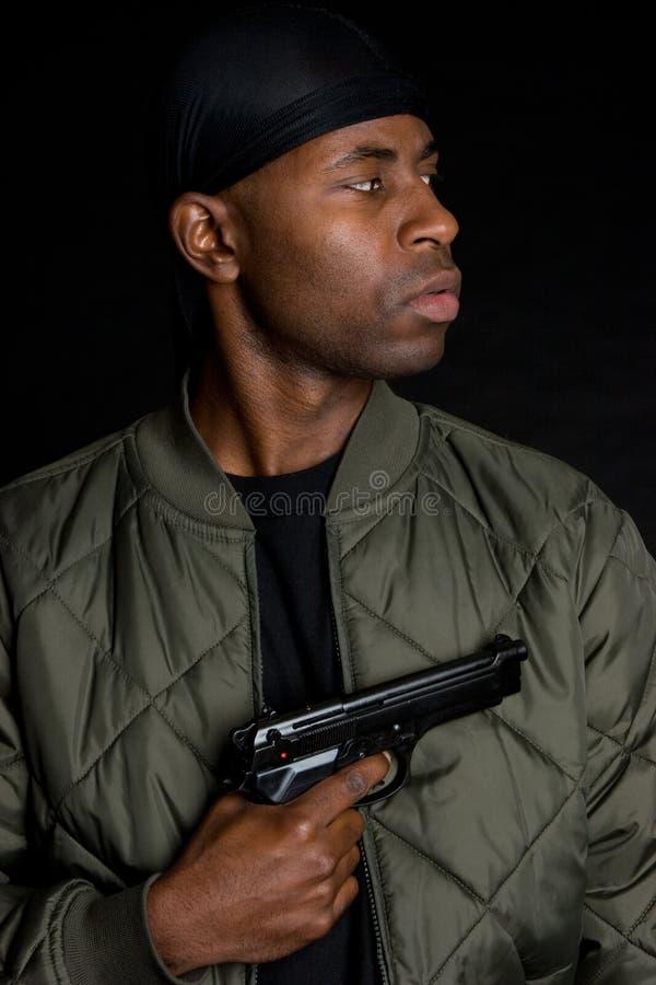 chłopiec czarny pistolet zdjęcie stock