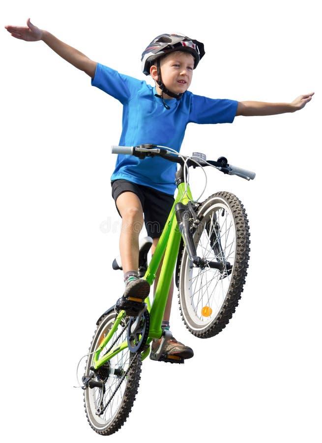 Chłopiec doskakiwanie na rowerze obraz stock
