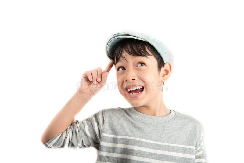 Chłopiec główkowania niespodzianki twarz dostaje pomysł na bielu fotografia stock
