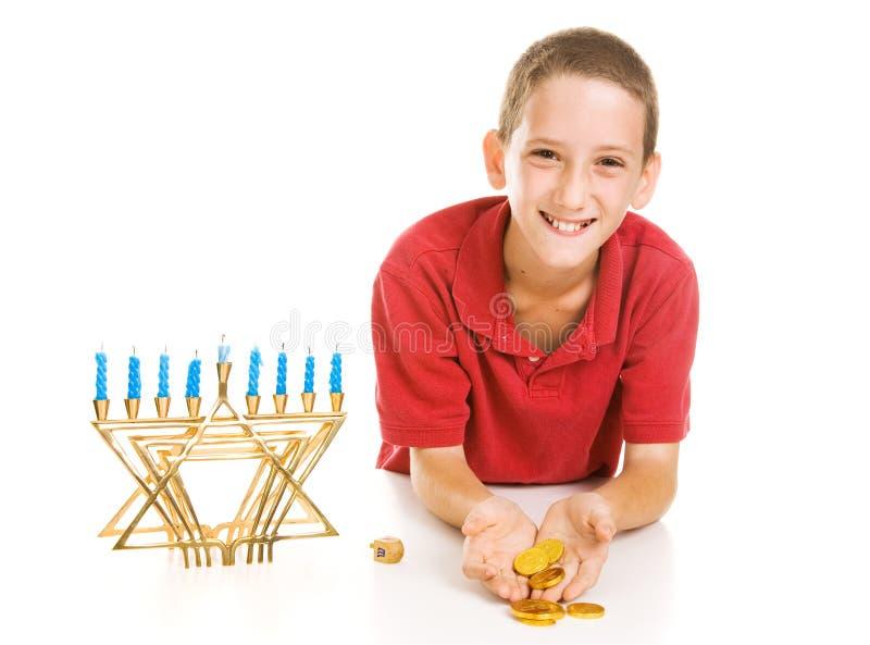 chłopiec gelt Hanukkah mienie obraz royalty free