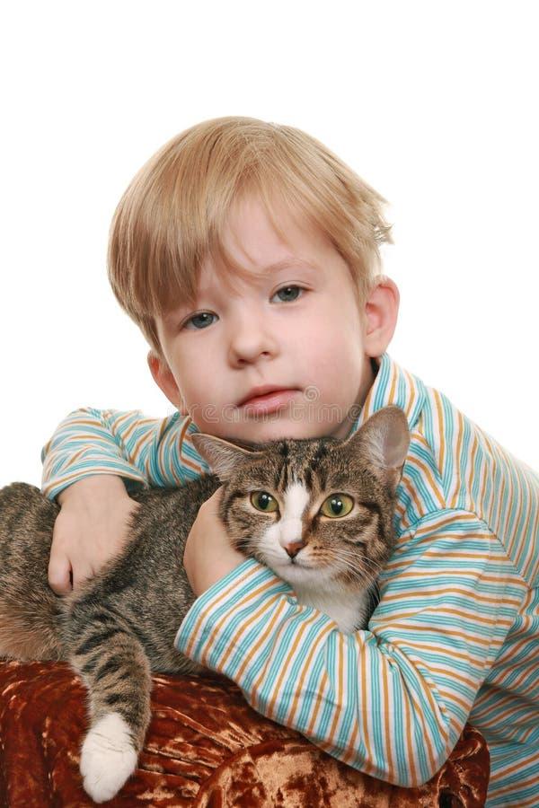 chłopiec gniewny kot fotografia royalty free