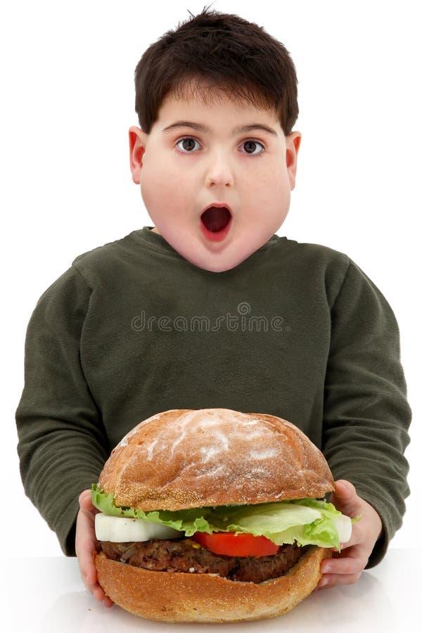 chłopiec hamburgeru gigantyczny głodny otyły zdjęcia royalty free