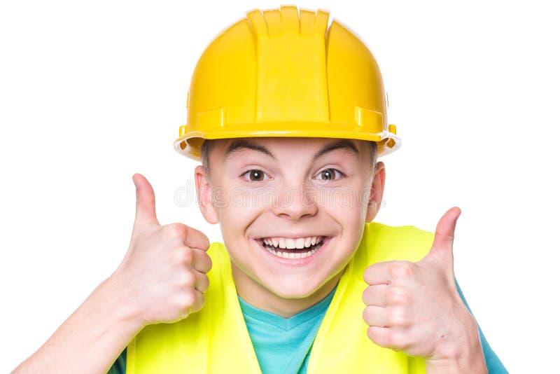 Chłopiec jest ubranym żółtego ciężkiego kapelusz obraz royalty free