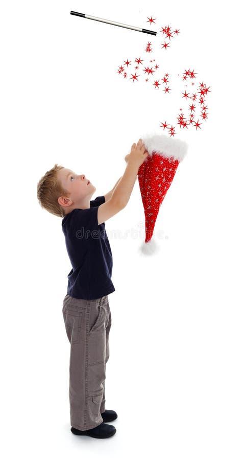 chłopiec kapeluszowego mienia mały czarownik zdjęcia stock