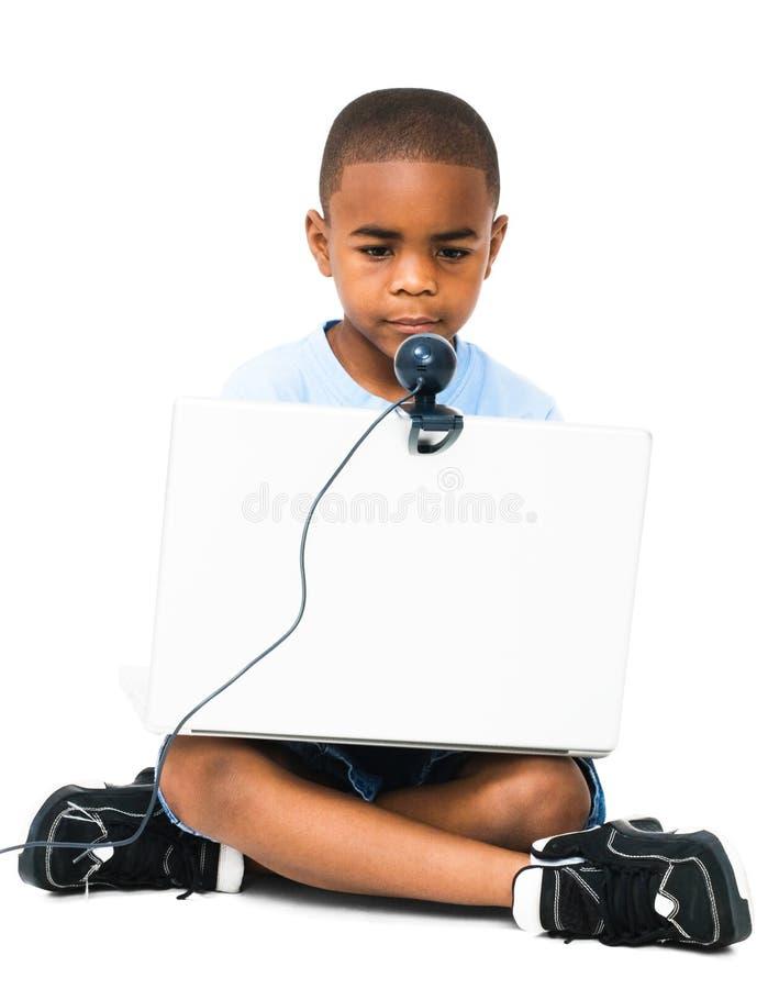 chłopiec laptopu używać fotografia stock