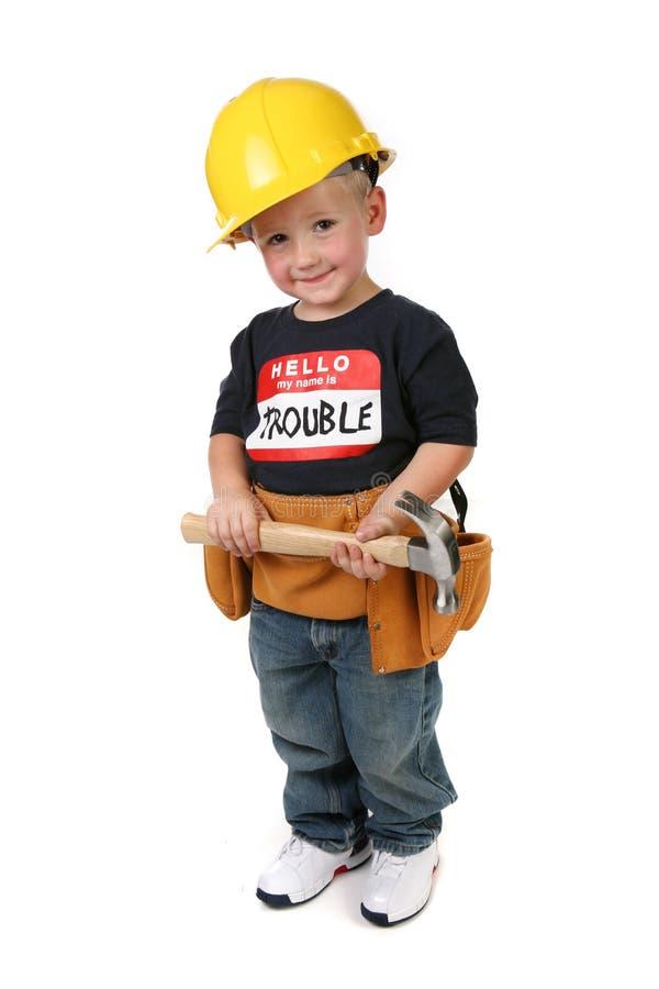 chłopiec młoteczkowy ciężkiego kapeluszu mienia toolbelt target925_0_ zdjęcia stock