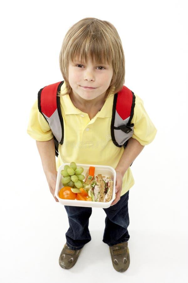 chłopiec mienia lunchbox portreta uśmiechnięty studio obrazy stock