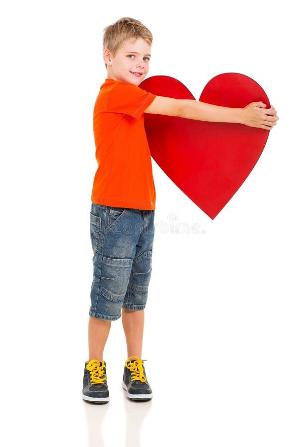 Chłopiec mienia serce fotografia royalty free