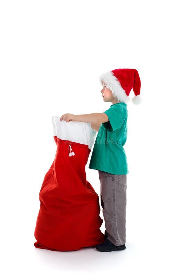 chłopiec mienia worka Santa potomstwa zdjęcie royalty free