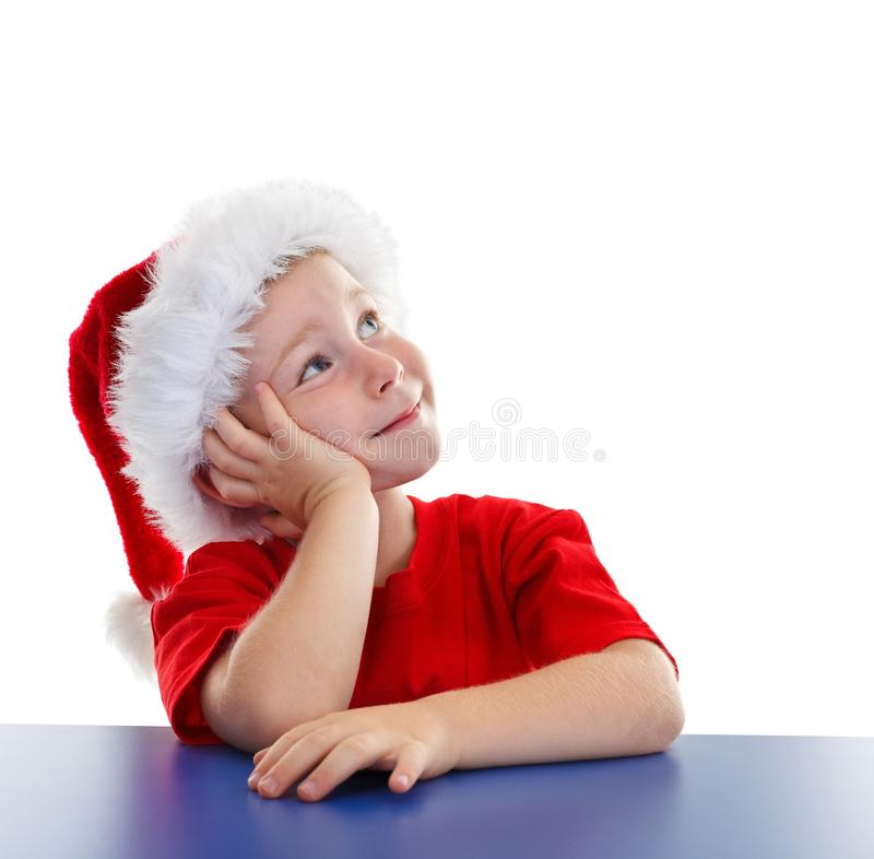 chłopiec odbitkowa kapeluszowa przyglądająca Santa przestrzeń zdjęcia royalty free