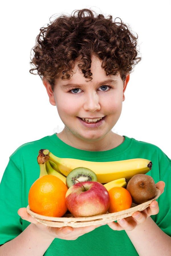 chłopiec owoc target1566_1_ obraz stock