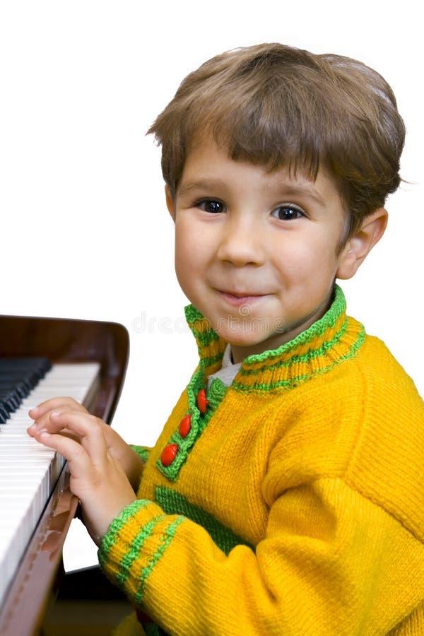 chłopiec pianino zdjęcia royalty free