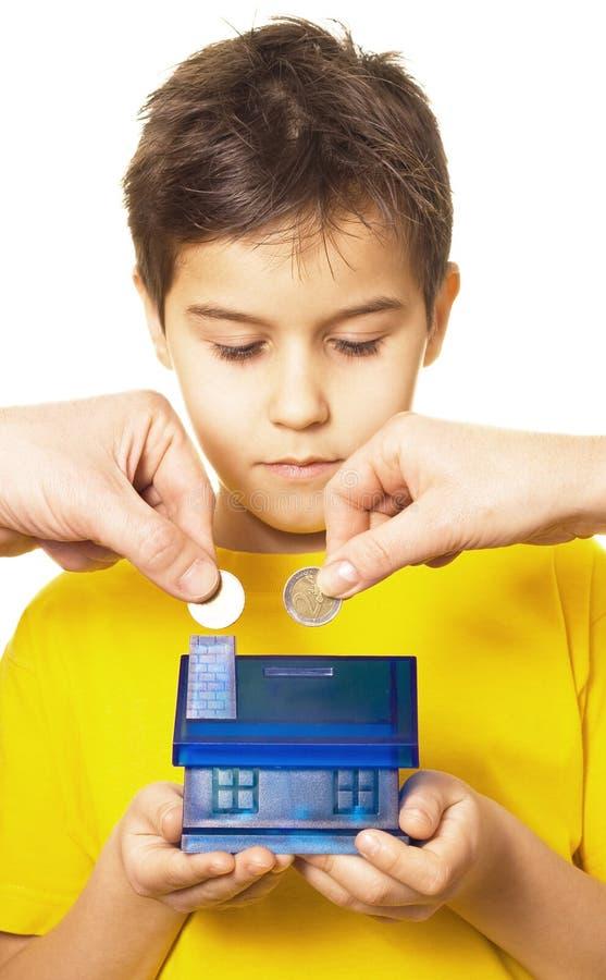chłopiec pieniądze oszczędzanie obrazy stock