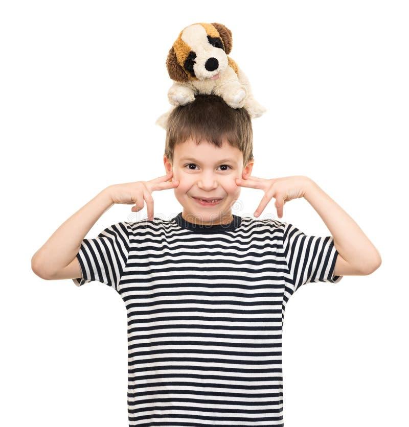 Chłopiec portret w pasiastej koszula na bielu zdjęcia stock