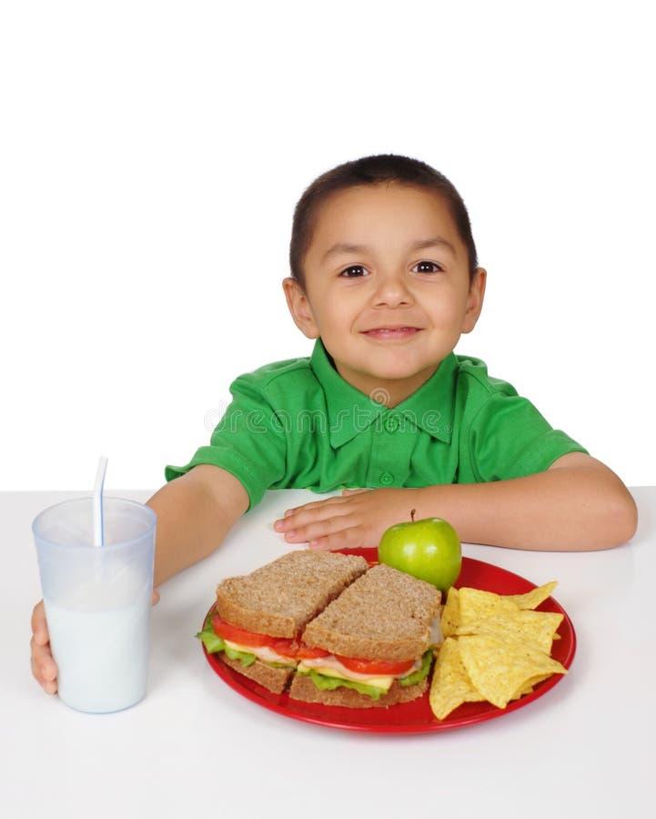chłopiec posiłku kanapka obraz royalty free