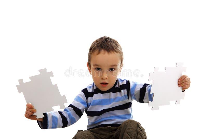 Chłopiec robi wyrzynarce na białym tle zdjęcia royalty free