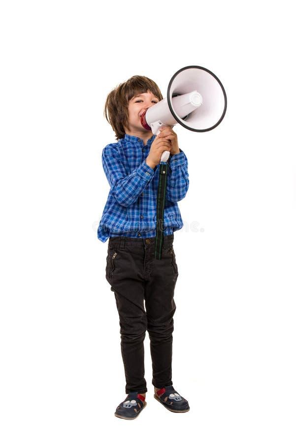 Chłopiec robi zawiadomieniu megafonem obrazy stock